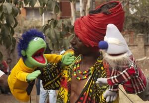 Kenyan Man With Puppets